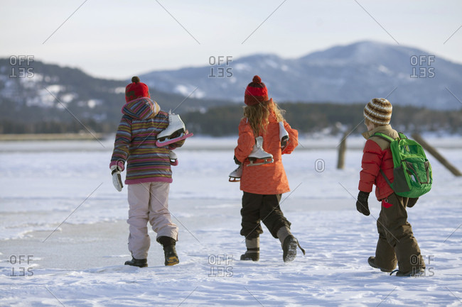 Two Young Girls And A Little Boy Heading Out For Some Winter Skating In Sandpoint, Idaho