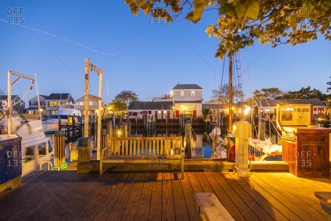 Nantucket Island, Massachusetts - September 19, 2013: Boats docked at Straight Wharf in the evening