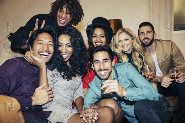 Portrait of happy Multi ethnic friends sitting together at party