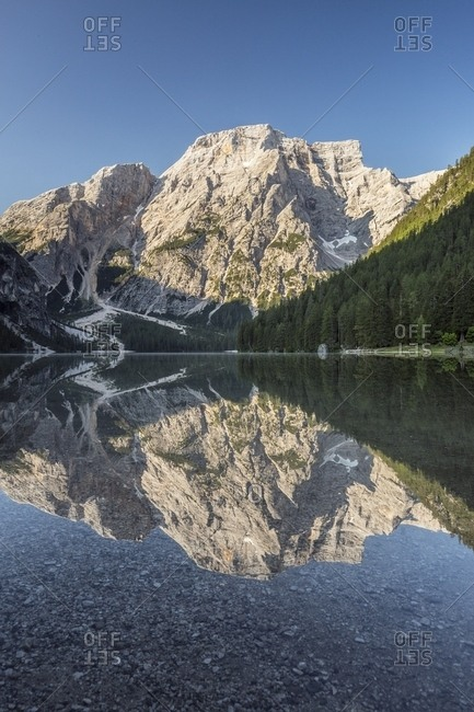 Braies Lake (Pragser Wildsee) with first light morning on Croda del Becco mountain (Seekofel), Dolomites, South Tyrol, Italy