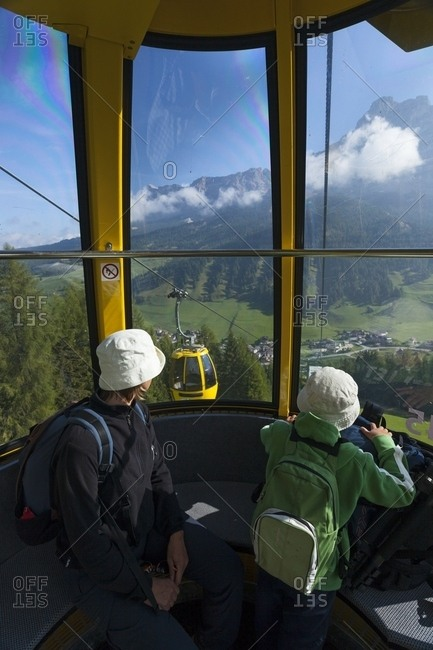 Tourists on gondola lift to Piz Sorega