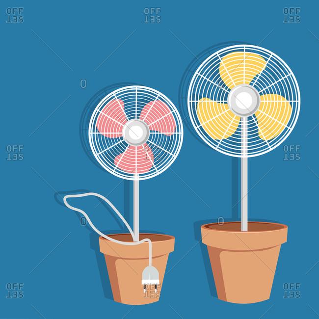 Two electric fans in flowerpots