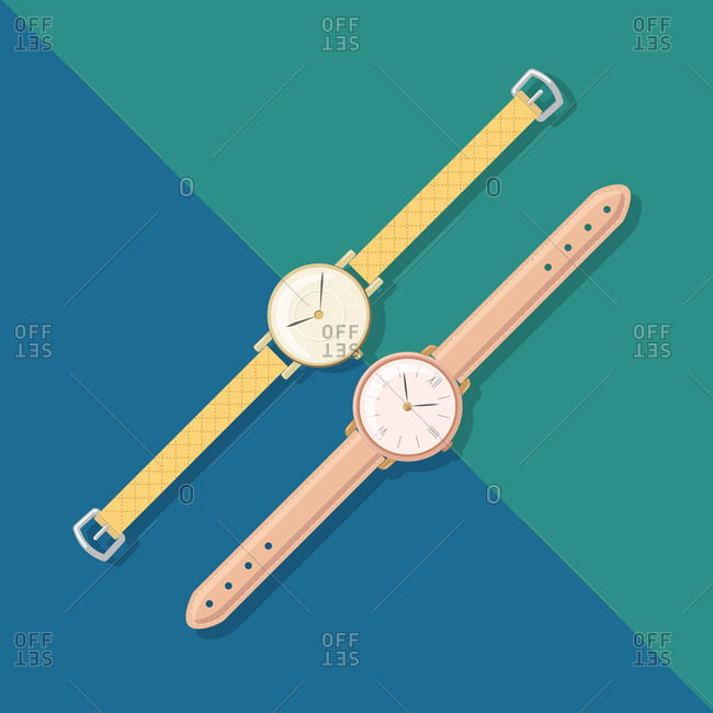 Two wristwatches on blue background
