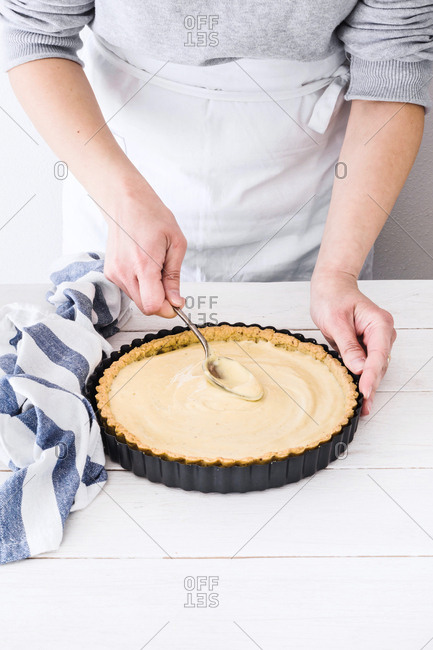 Woman preparing an apples and honey tart