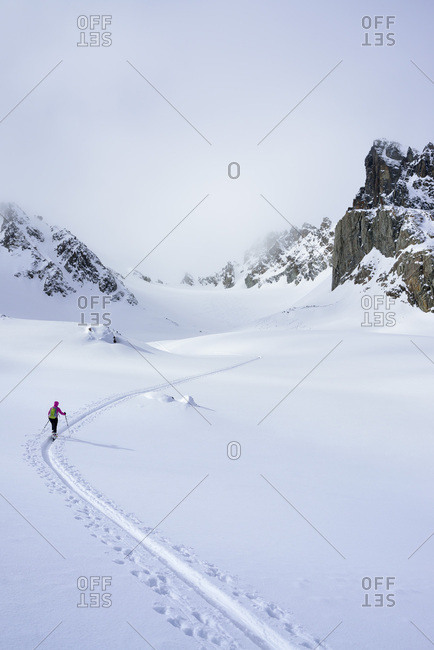 Female ski tourer ascending to Piz Sasuret, Piz Sasuret, Albula Alps, Engadin, Canton of Graubuenden, Switzerland