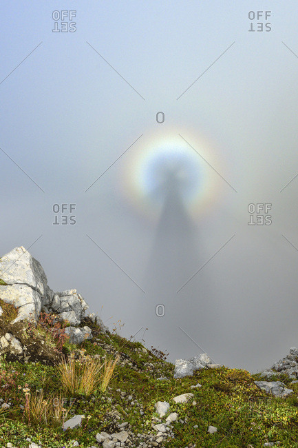 Optical phenomenon of Brocken Specter, Latemar range, Dolomites, UNESCO world heritage Dolomites, Trentino, Italy