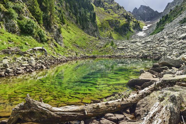 Blue-green mountain lake, lake Lago Caserina, Lagorai range, Dolomites, UNESCO world heritage Dolomites, Trentino, Italy