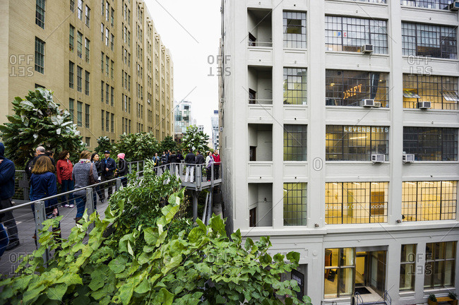 New York, NY - October 11, 2014: People walking along the High Line Park in Chelsea