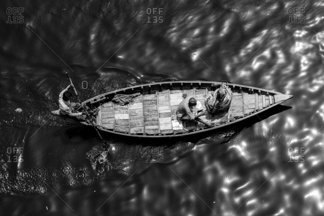 Dhaka, Bangladesh - March 31, 2014: Wooden boat as water-taxi over the Buriganga River