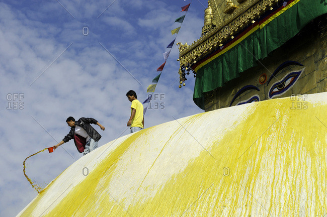 Kathmandu, Nepal - September 29, 2011: Men painting the structure on top of the Swayambhunath Stupa