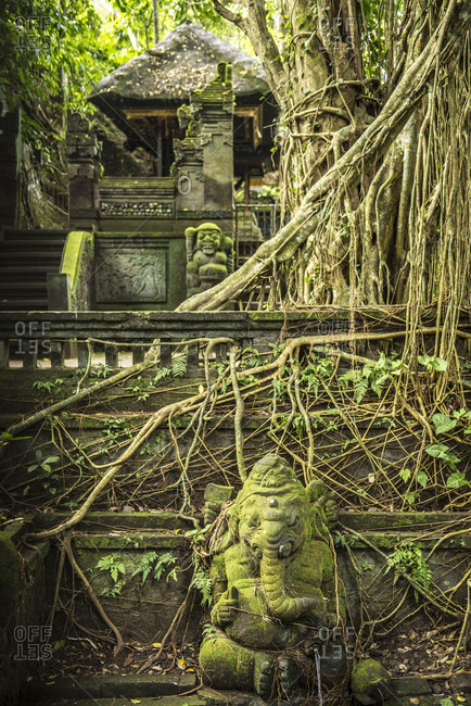 Balinese temple entrance with monkey statues in the temple town of Ubud, Bali, Indonesia
