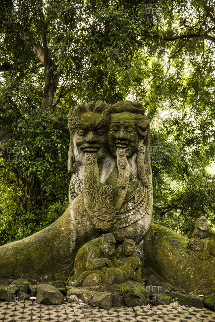 Balinese stone temple figures heads in the city of Temple Ubut, Bali, Indonesia