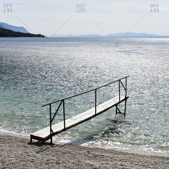 Landing stage at the beach, coast near Jakirusa, Brela, Adriatic Sea, Mediterranean Sea, Makarska Riviera, Dalmatia, Croatia