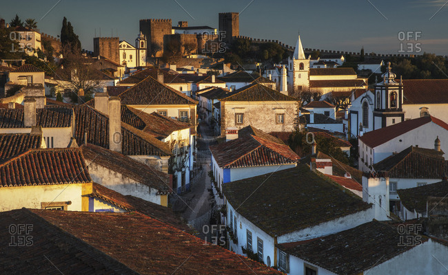 Sunrise over the roofs of Obidos, Portugal.