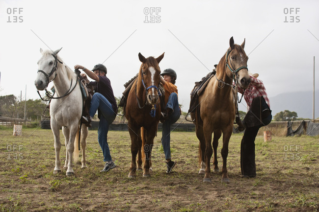 Horse riders mounting their horses