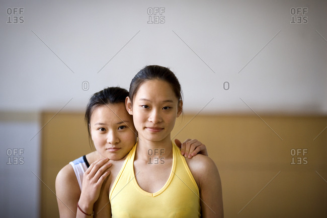 Two teenage girls in a gym