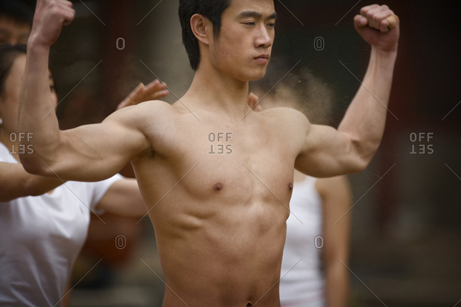 Gymnast flexing his muscles