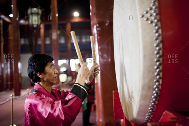 Man playing an oriental drum