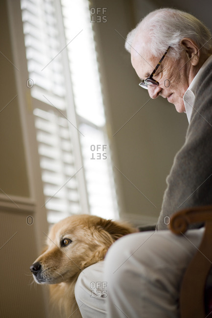 Senior man petting his dog