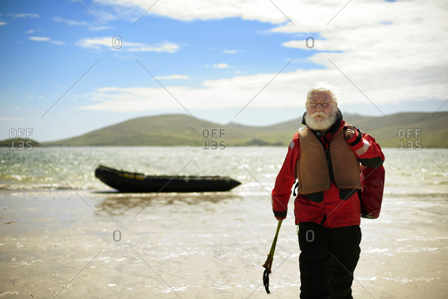 Senior man coming to shore after a boat trip