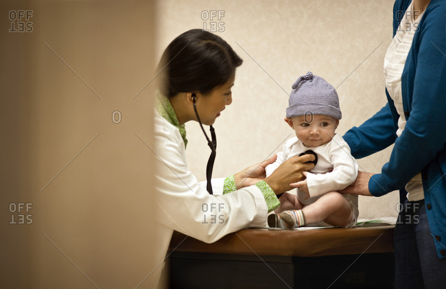 Baby being examined by a doctor