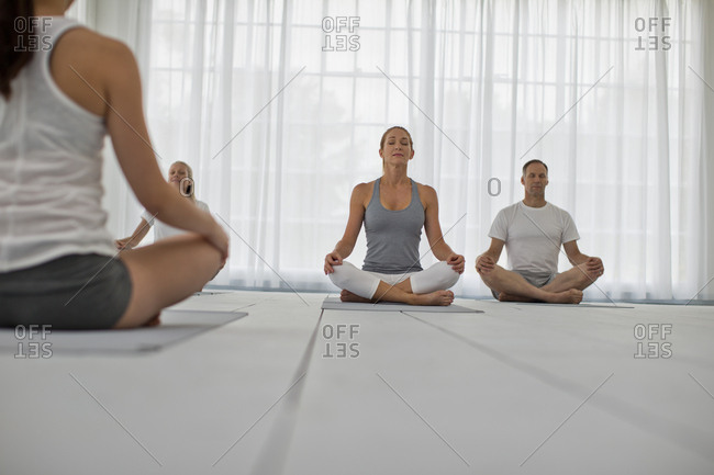 People meditating during a yoga class