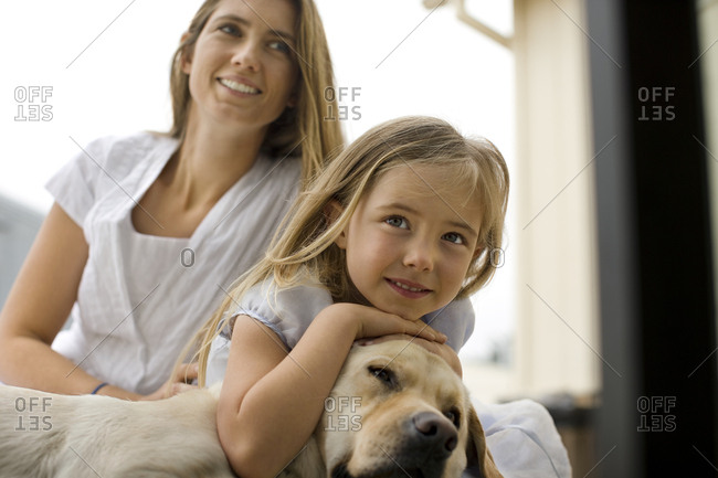 Mother and daughter with their dog