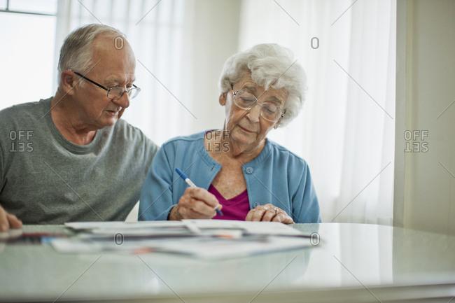 Senior couple working on their home finances