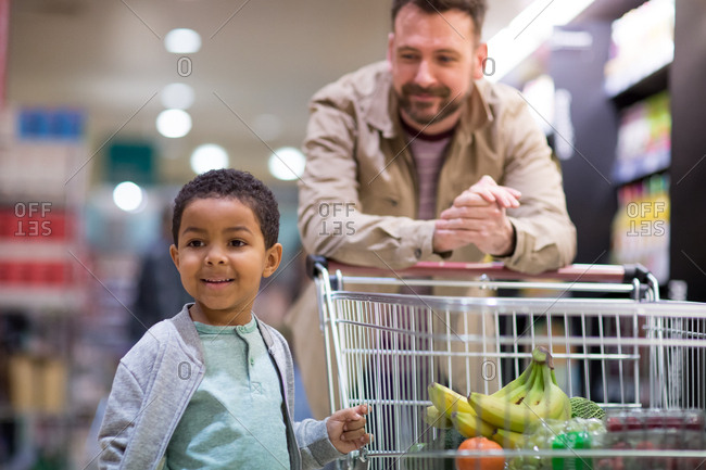 Father and son doing weekly shop in grocery store
