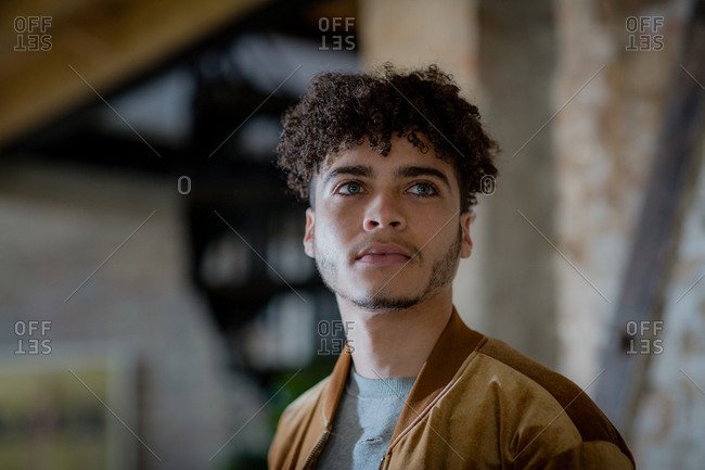 Multiracial young adult male looking to future