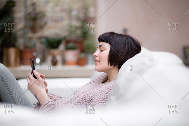 Young adult female on smartphone
