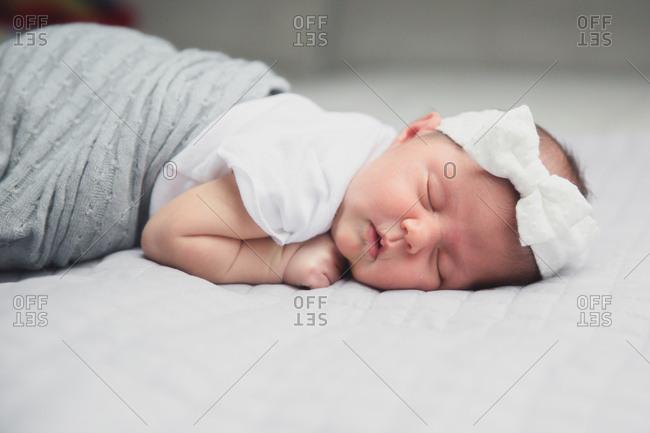 Baby asleep with bow headband