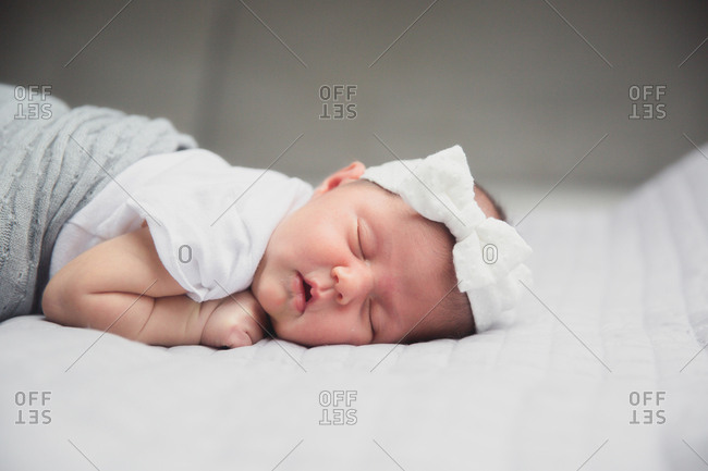 Baby asleep with a bow headband