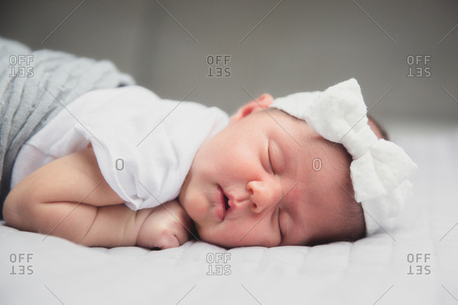 Baby asleep in a bow headband