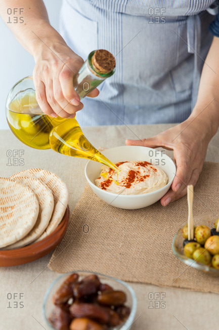 Woman cooking hummus