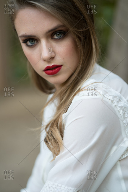 Portrait of beautiful female with strong makeup