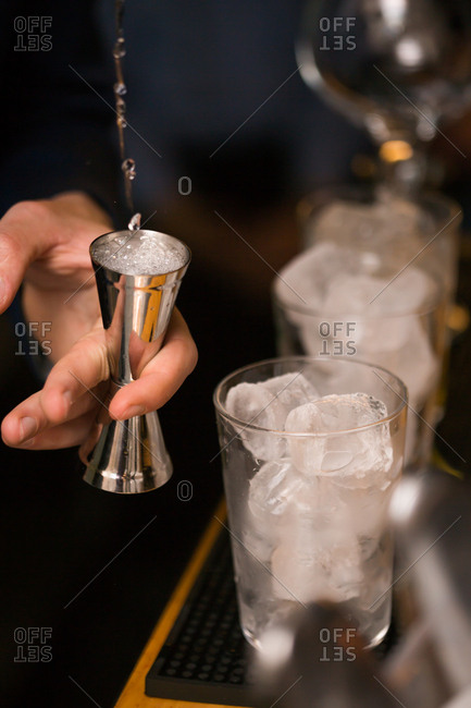 Barman preparing cocktails in pub