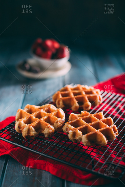 Waffles in a grid with icing sugar and strawberries