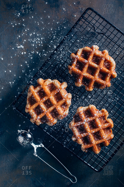 Waffles in a grid with icing sugar