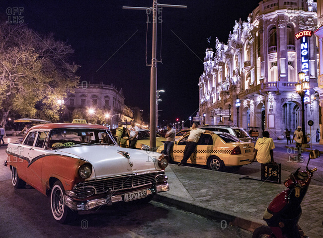 Taxis and classic American cars on street in Havana near the Great Theatre of Havana Alicia Alonso