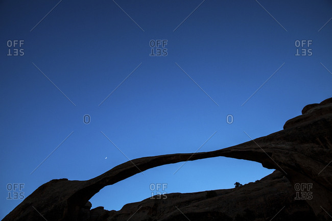 Crescent moon over Landscape Arch in Utah's Arches National Park