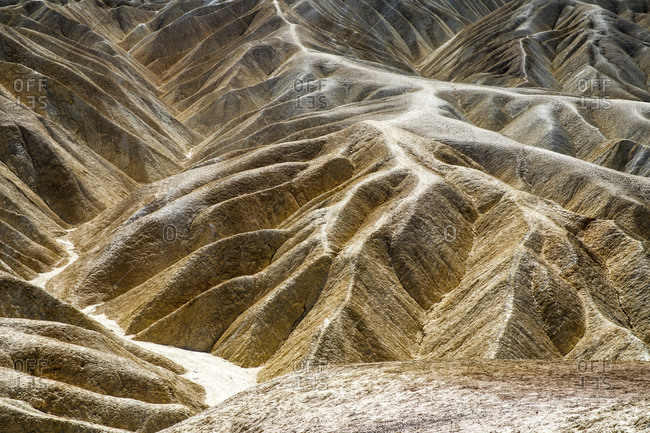 Trails mark the badlands of Zabriskie Point in Death Valley National Park