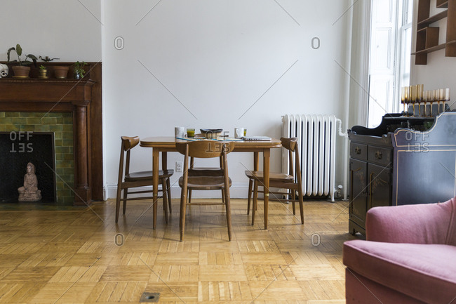 Wooden dining room table in an apartment