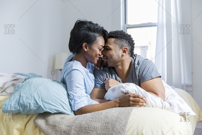 Couple embraced on a bed