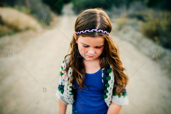 Girl in headband and crocheted sweater
