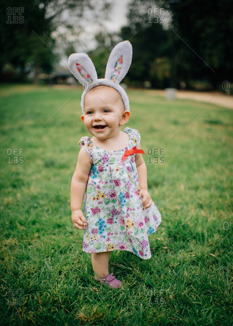 Toddler girl laughing in Easter outfit