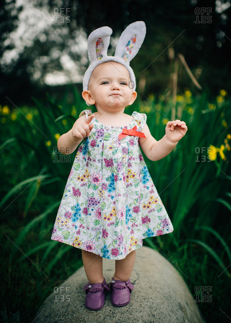 Girl on rock in an Easter outfit