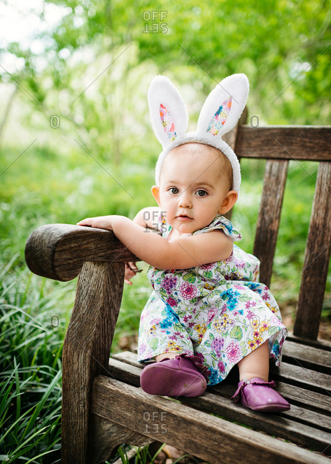 Girl in Easter outfit on bench