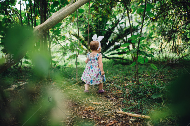 Toddler in Easter outfit in woods