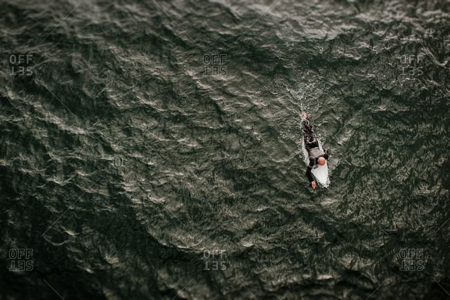 Aerial view of person on surfboard